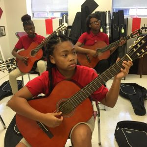 Students playing guitar at Jennings Junior High.